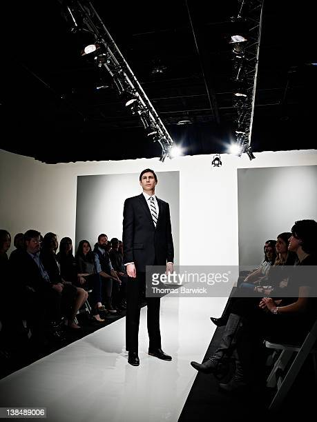 Businessman in suit standing on catwalk