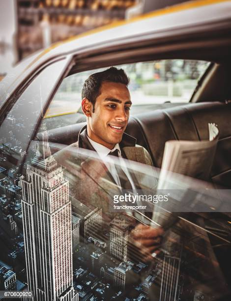 businessman in taxi in nyc