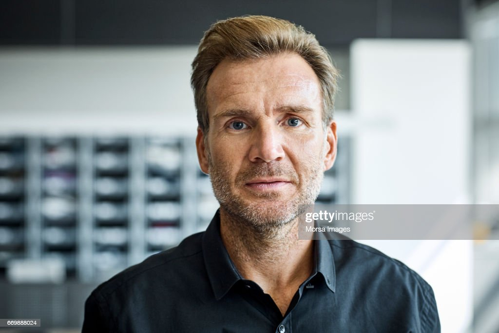 Businessman in textile factory : Stock Photo