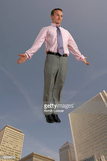 Businessman in the air with city in the background