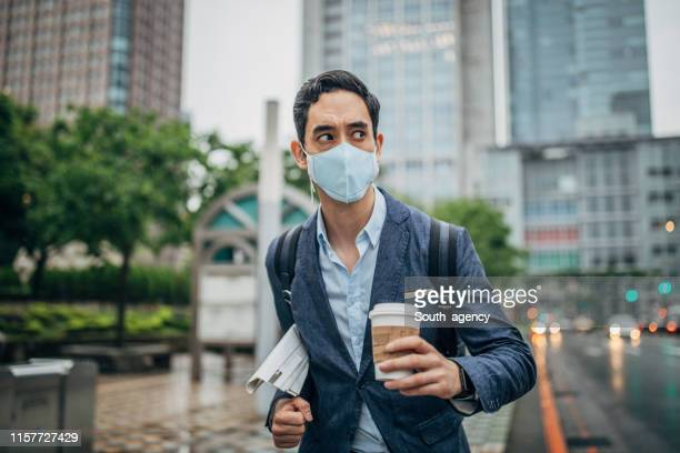 businessman in the city - pandemic illness stock pictures, royalty-free photos & images