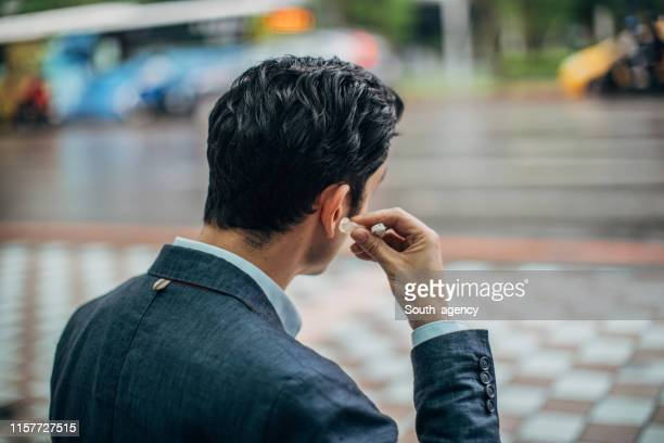 businessman in the city - hearing aid stock pictures, royalty-free photos & images