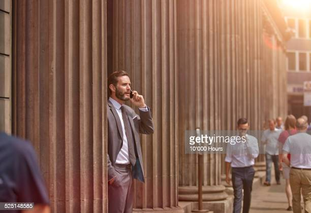a businessman in the city talking on phone - incidental people stock pictures, royalty-free photos & images