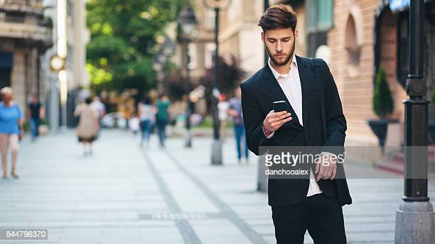 Businessman in the city using smart phone