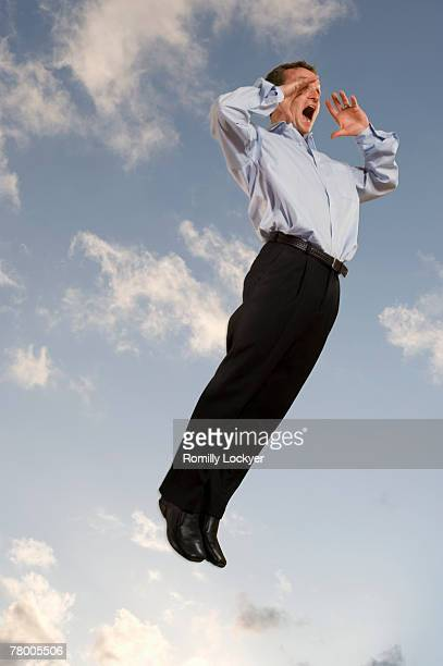 Businessman in the sky shouting