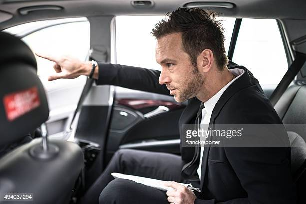 businessman in the taxi car showing the route