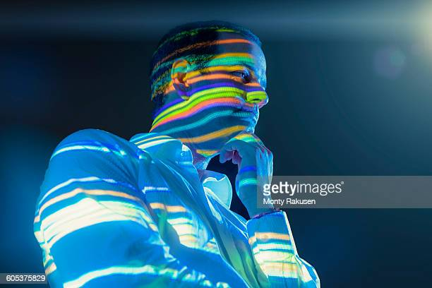Businessman in thought with projected graphical financial data