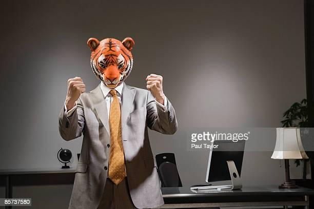 Businessman in tiger mask