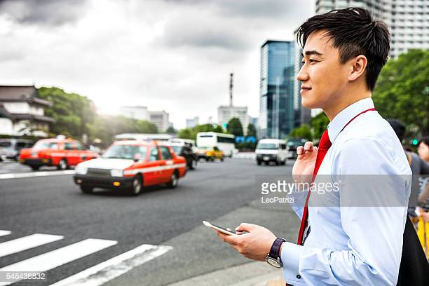 Businessman in Tokyo waiting for car pooling