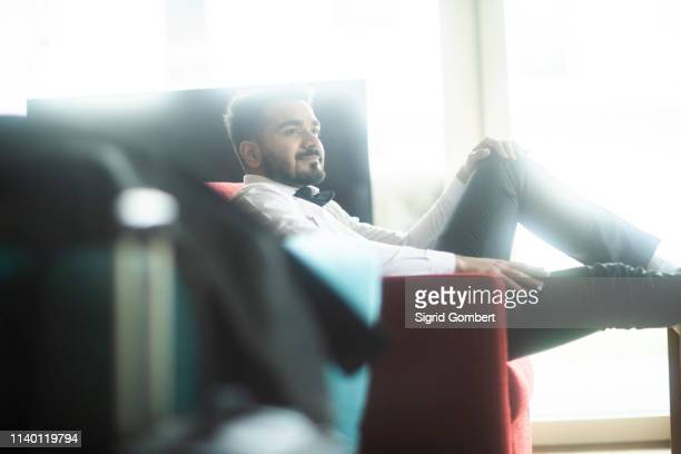 businessman in travel lounge - sigrid gombert stock pictures, royalty-free photos & images