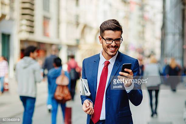 Businessman in Turkey with smart phone texting