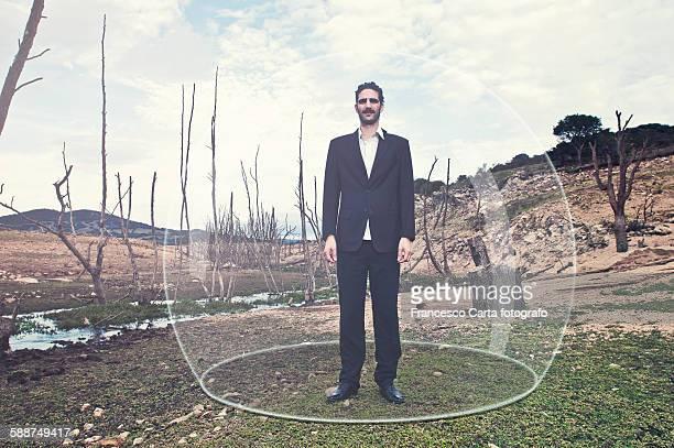 Businessman inside a glass bubble