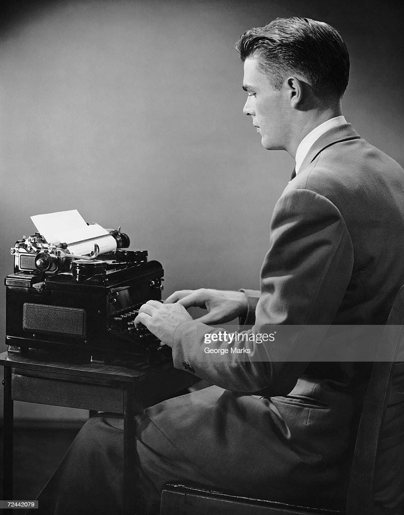 Businessman inside office typing : News Photo