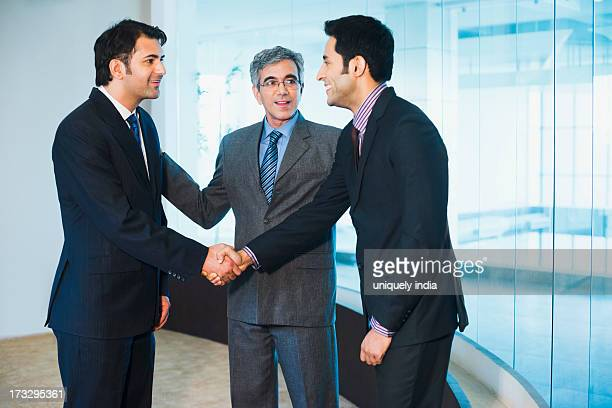 Businessman introducing his colleague to another businessman