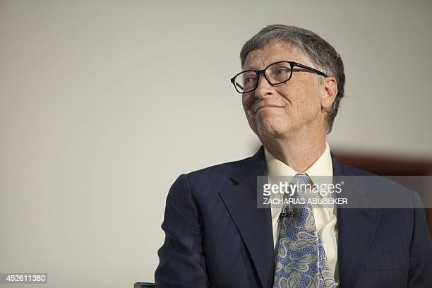 US businessman inventor and philanthropist Bill Gates cochair of Bill and Melinda Gates Foundation delivers a speech after receiving an honourary...