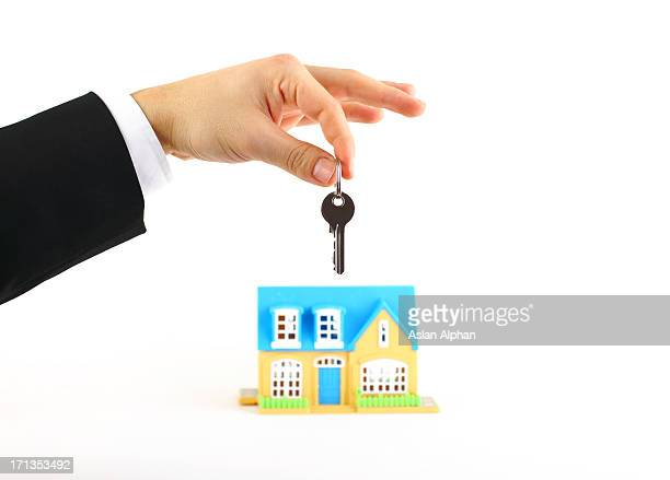 Businessman is holding a house key