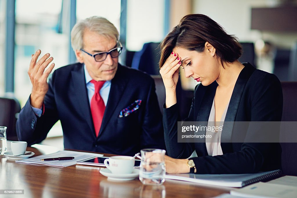 Businessman is insulting his secretary : Stock Photo