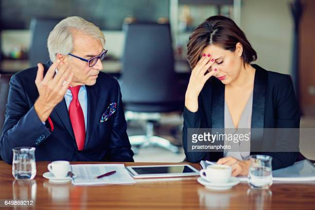 businessman is insulting his secretary - bossy stock pictures, royalty-free photos & images