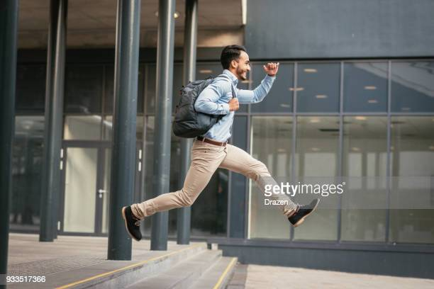 businessman is running to catch the train - jumping stock pictures, royalty-free photos & images