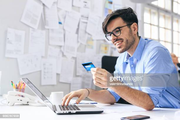 Businessman is shopping online