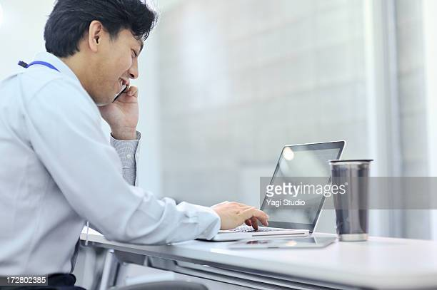 Businessman is working on a laptop computer,Japan