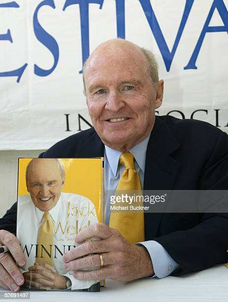 Businessman Jack Welch holds a copy of his book Winning as he attends the 10th annual Los Angeles Times Festival of Books at UCLA on April 24 2005 in...