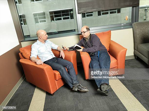 Businessman Jeff Bezos with Paris Match journalist Paul Khayat photographed at Amazon headquarters for Paris Match on February 13 2012 in Seattle...