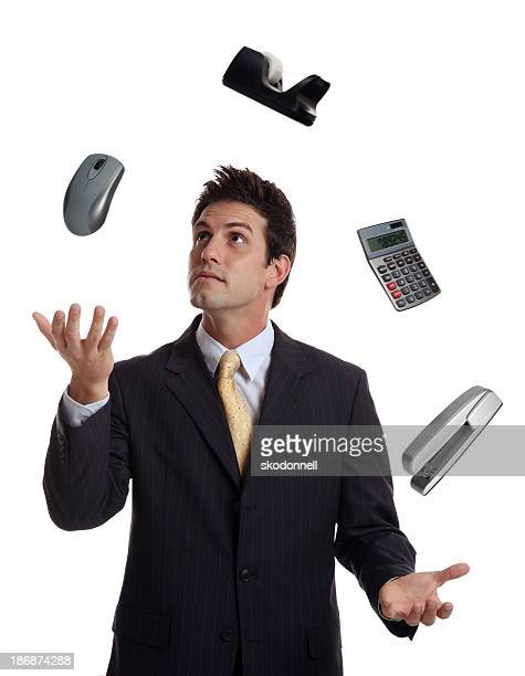 Businessman Juggling Office Supplies