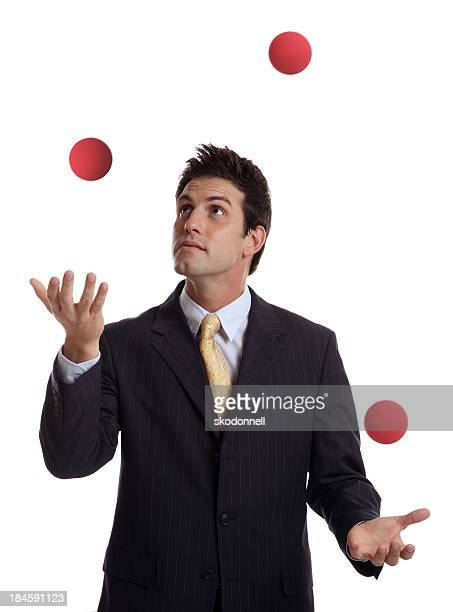 Businessman Juggling Red Balls