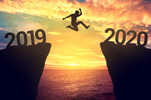 Businessman jump between 2019 and 2020 years. 1134732907