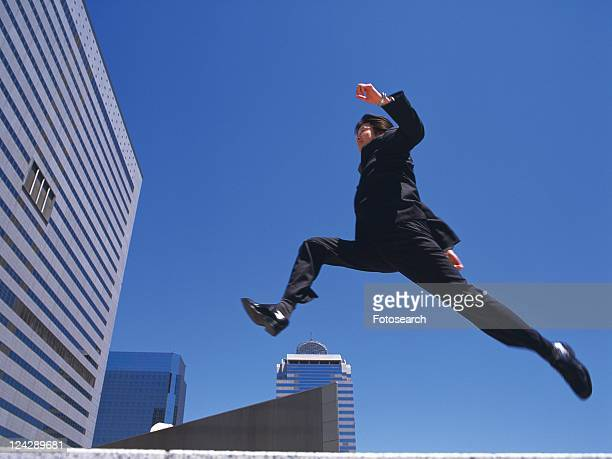 Businessman jumping and running , Low Angle View