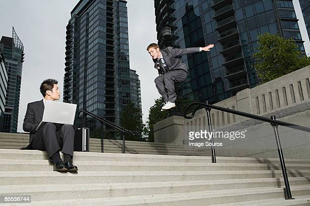 Businessman jumping at colleague