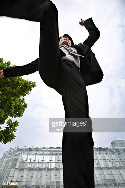 businessman jumping, directly below - 真下からの眺め ストックフォトと画像