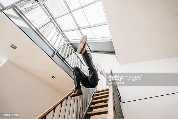 businessman jumping down stairs - aufstand stock-fotos und bilder