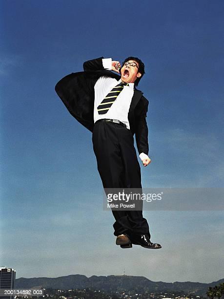 実業家で、終始フリッパーズ・ギター時代のジャンプの空気に携帯電話、低角度