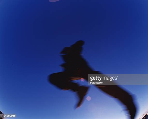 Businessman Jumping, Low Angle View, Lens Flare, Long Exposure