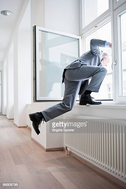 Businessman jumping out of window