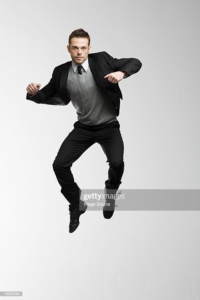 A businessman jumping : Stock Photo