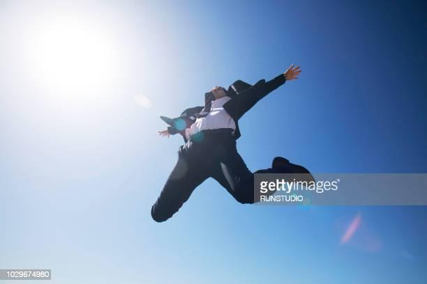 businessman jumping up - 喜び ストックフォトと画像