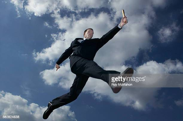 Businessman Jumping with Baton