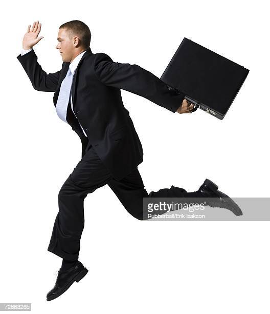 Businessman jumping with briefcase