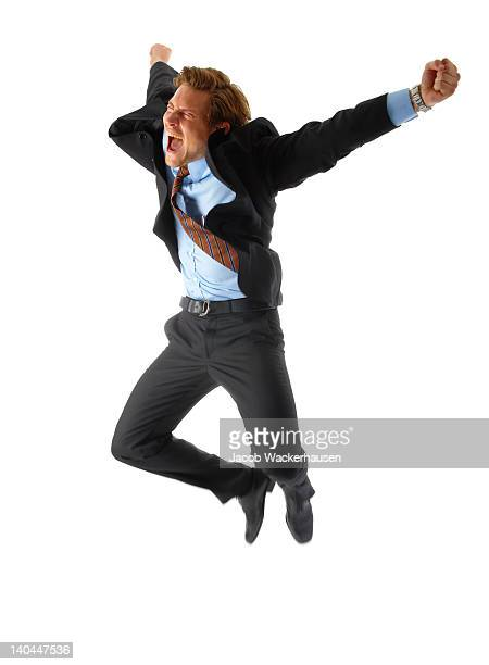 Businessman jumping with joy