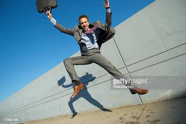 Businessman Jumps on Sidewalk