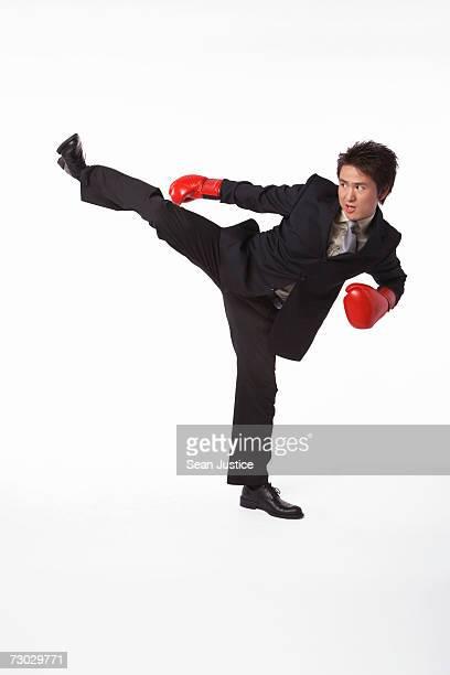Businessman kickboxing