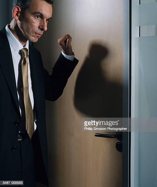 businessman knocking on door - knocking on door stock photos and pictures