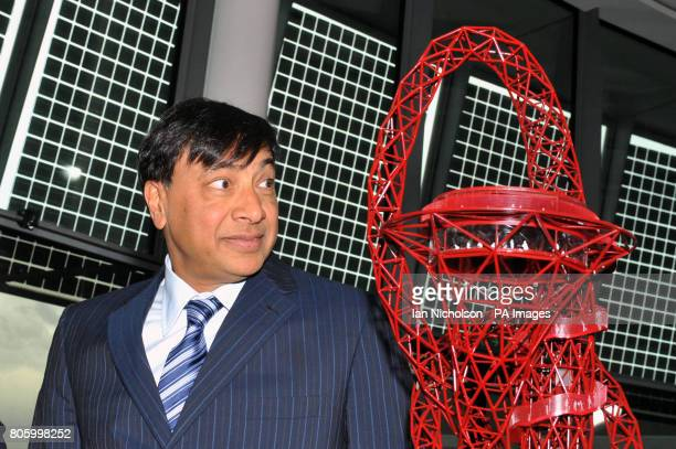 Businessman Lakshmi Mittal looks at a scale model of the proposed ArcelorMittal Orbit tower which was unveiled by London mayor Boris Johnson at City...