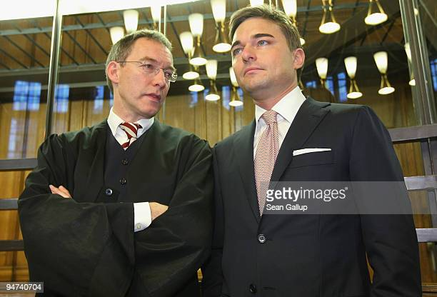 Businessman Lars Windhorst chats with his lawyer upon his arrival for the first day of his trial at the Landgericht Berlin courthouse on December 18...