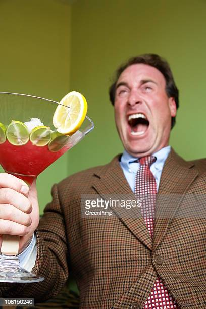 Businessman Laughing and Drinking Cocktail