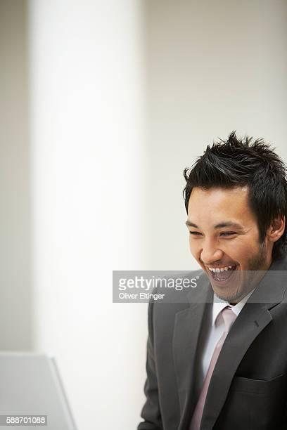 businessman laughing - oliver eltinger stock-fotos und bilder