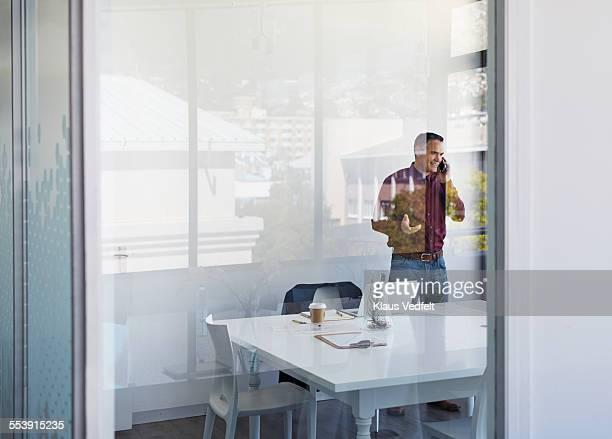 Businessman laughing while on the phone